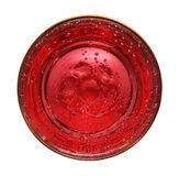Glass with red aerated water Royalty Free Stock Image