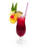Glass of red alcoholic drink with pineapple, cherry, orange and ice. Royalty Free Stock Photography