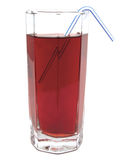 Glass of red apple juice with tubule. Isolated on white background Royalty Free Stock Photography