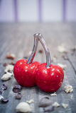 Glass red cherry decor object Royalty Free Stock Images