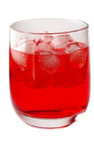 Glass of red drink with ice Stock Photos