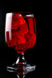 Glass of red drink with ice Royalty Free Stock Photos