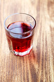 glass with red drink Stock Photography