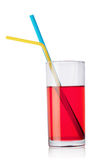 Glass of red drink and tubes Royalty Free Stock Photo