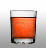 Glass with red fizzy cocktail on gradient background Royalty Free Stock Photos