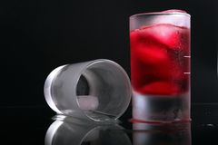 Glass with red fluid Stock Images