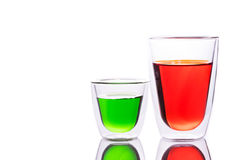 Glass of red and green water Royalty Free Stock Photos