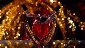 Glass Red Heart Valentines day studio work. Red yellow gold bokeh stock footage