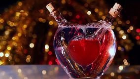 Glass Red Heart Valentines day studio work. Red yellow gold bokeh stock video footage