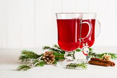 A glass of red hot mulled wine on a light background. Christmas and New Year greeting card. Stock Images