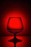 Glass in red light. Empty glass in red light Royalty Free Stock Images