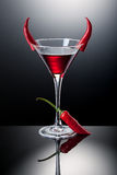 Glass of red martini decorated with chili pepper Stock Photos