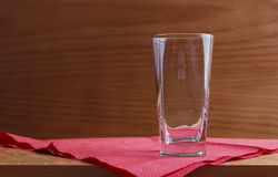 Glass on red napkin Royalty Free Stock Photo