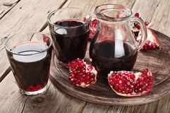 Glass of red pomegranate juice with slices of pomegranate Royalty Free Stock Photography