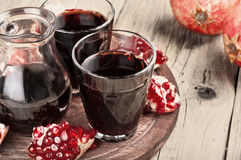 Glass of red pomegranate juice with slices of pomegranate Stock Photo