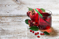 Glass of red pomegranate juice, summer drink. Glass of red pomegranate juice. Selective focus. Copy space background Stock Photography