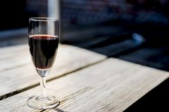 Glass of red port, on wooden table stock photo