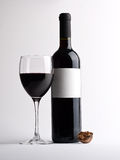 Glass of red vine with bottle Royalty Free Stock Photography