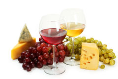 Glass of red and white wine, cheeses and grapes isolated on a white Stock Images