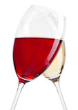 Glass of red and white wine in motion on white Royalty Free Stock Images