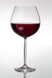Glass with red wine. HQ studio shot. Camera: Canon EOS 5D Mark II Stock Images