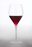 Glass with red wine. HQ studio shot. Camera: Canon EOS 5D Mark II Royalty Free Stock Photography