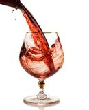 Glass of Red Wine. Red wine being poured into a wine glass Stock Images