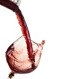Glass Red Wine. Red wine being poured into a wine glass Royalty Free Stock Image