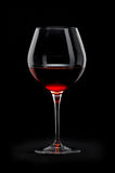 Glass of red wine. Over black background stock photography