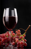 Glass of red wine. With grapes Royalty Free Stock Image