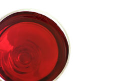 A glass of red wine. A top view of a glass of red wine, air bubbles in the wine are also visible,with blank space for further editing by designers Royalty Free Stock Photo