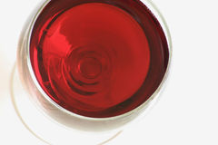 A glass of red wine. A top view of a glass of red wine, air bubbles in the wine are also visible Royalty Free Stock Photos