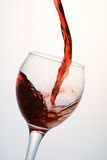 Glass of red wine. Jet Filling a glass of red wine Royalty Free Stock Image