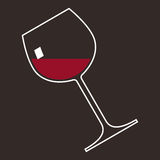 A glass of red wine. On a brown background Royalty Free Stock Photo
