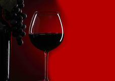 Glass of red wine. And bottle with grape Stock Photo