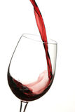 Glass Red Wine. Red wine being poured into a wine glass Stock Photos