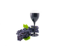 Glass of red wine. And grapes isolated on a white background Royalty Free Stock Images