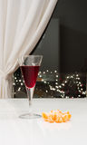 Glass with red wine. Against window Stock Photo