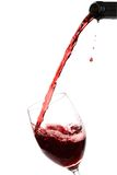 Glass Red Wine. Red wine being poured into a wine glass Stock Photo