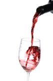 Glass Red Wine. Red wine being poured into a wine glass Royalty Free Stock Images