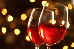 Glass of red wine against defocussed lights Royalty Free Stock Photos
