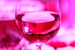 Glass of red wine as on pink picture Royalty Free Stock Photo