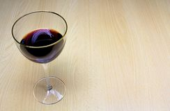 A glass of wine on a wooden background stock photography