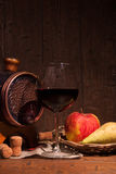 Glass of red wine and barrel on rustic wood tabel Stock Photos