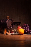 Glass of red wine and barrel on rustic wood tabel.  Stock Photography