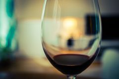 A glass of red wine. A glass of red wine with beautiful bokeh Royalty Free Stock Photos