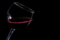 A glass of red wine on black background Royalty Free Stock Photos