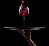 Glass of red wine on a black Royalty Free Stock Image
