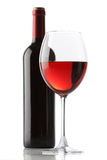 Glass of red wine and a bottle Royalty Free Stock Image