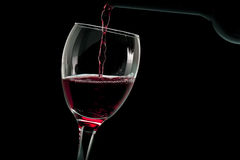 Glass of red wine with bottle Stock Images